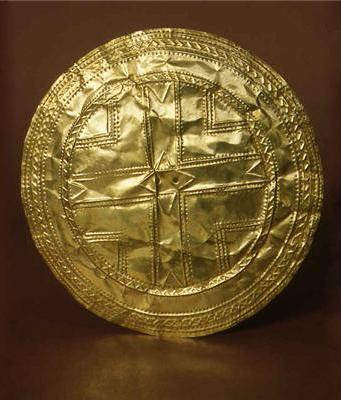 Gold Disc,  Teldavnet, Co Monaghan. In this Gold Disc you can see just how thin the gold has become from being hammered- its like gold foil. You can also see the two holes in the centre which were used to fasten the gold disc using gold wire.