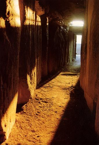Passage at Newgrange showing the Roofbox and the entrance. Courtesy OPW