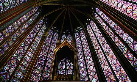 Soaring stained glass windows reach daring heights in the 13th-century Gothic Saint-Chapelle church in Paris. Photograph: Pascal Deloche/Godong/Corbis